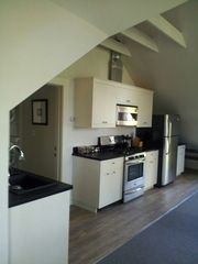 Essex studio photo - Kitchen: dishwasher, gas range, disposal, microwave/range hood, fridge w/icemake