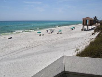 150 feet of private beach! Umbrella and chairs available to rent.