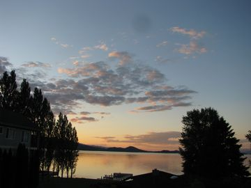 Polson house rental - Sunset from our lakeside deck.