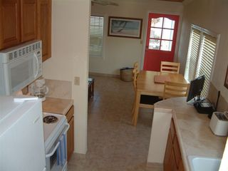 Great Exuma villa photo - Kitchen/Dining area - fully equipped home away from home w TV/DVD, & FREE WiFi!