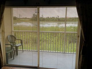 Celebration condo photo - View of conservation Lake from Living Room Area, Quiet and Tranquil