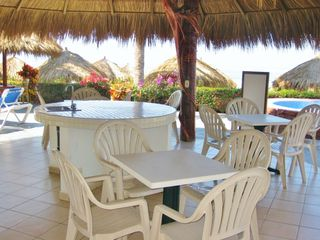 Nuevo Vallarta condo photo - There's a grill, sink and tables for dining by the pool