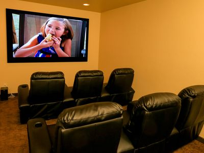 "Lower level - Theater with 100"" screen and high quality surround sound."
