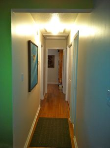 Hallway to bedrooms. Home is all wood and tile floors.