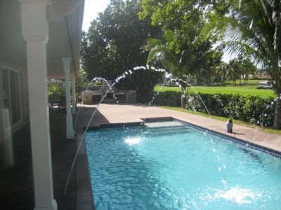 Private backyard with heated pool overlooking Diplomat golf course