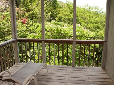 Lounge on the private deck off the second bedroom while enjoying the gardens.