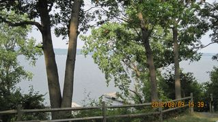 Ithaca cottage photo - Take in Cayuga Lake from the deck.