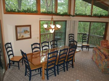 Great room dining area adjoining kitchen, sunroom