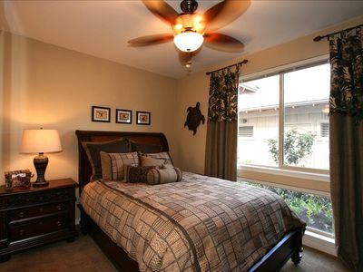 Downstairs guest bedroom with queen bed, armoire w/flat screen and full bathroom