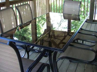 Sreened-in porch table & 6 chairs & veiw of lake