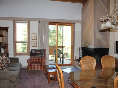 Open Living Area with wood-burning fireplace, sleeper sofa, and great view.