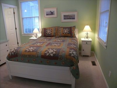 2nd master suite on first floor with queen bed and private bath
