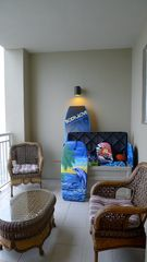 Perdido Key condo photo - 2nd Balcony.Deck Box full of Beach Toys,Floats.Boogie Boards,Extra Chairs.