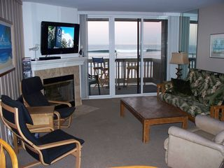 Oceanside condo photo - Living room with ocean view and 42 inch TV - those are the waves!