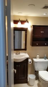 First bathroom with tub and shower
