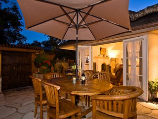 Carmel house photo - Patio seating with open great room French doors and DragonFyre side gate in the