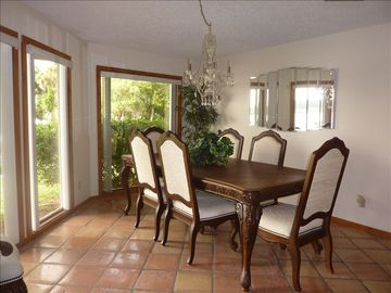 Large dining room that will accomodate up to 8 people.
