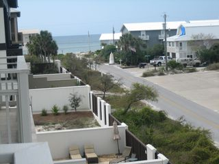 Inlet Beach townhome photo - View from 3rd floor balcony south to beach access. Rear gate leads to Beach