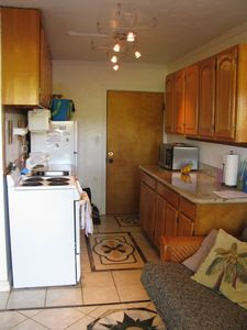 Kitchen with Granite Contertops and a full stove, microwave and coffee maker.