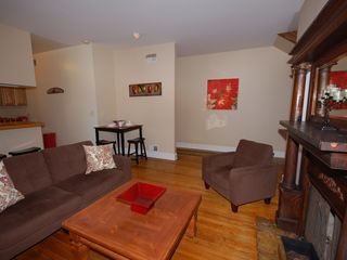 Capitol Hill apartment photo - Large living room with decorative fireplace