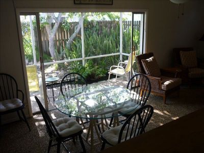 Lanai Dining area with enclosed fish pond