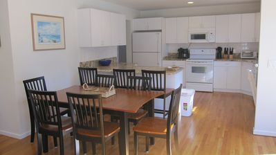 New Dining Set with Counter Stools, spotless kitchen with granite tops.
