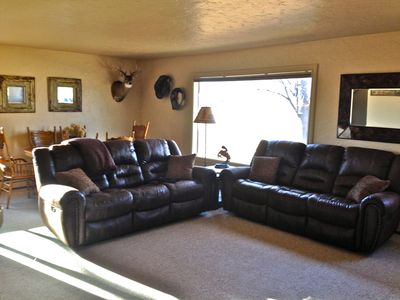 Large, reclining couches in the living room for relaxing.