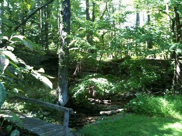 A year-round brook flows through the back of the property