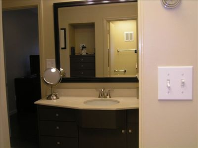 Vanity in Full Bath. Adjoining space includes a shower/tub combo