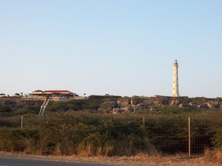 Aruba condo photo - Restaurant and lighthouse in Malmok for drinks and sunset, great views of golf
