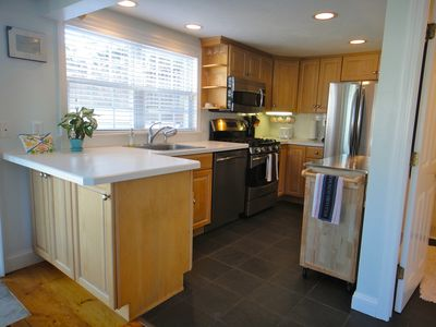 Freshly updated kitchen with SS appliances, slate floor and radiant heat.