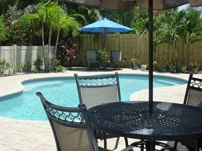 Heated saltwater pool, paver patio, tropical landscape, grill & outdoor shower.