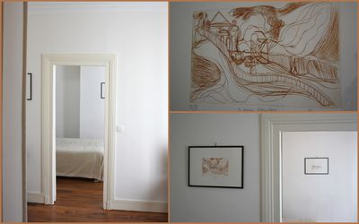 Living room with original drawings by Paolo Leoncini