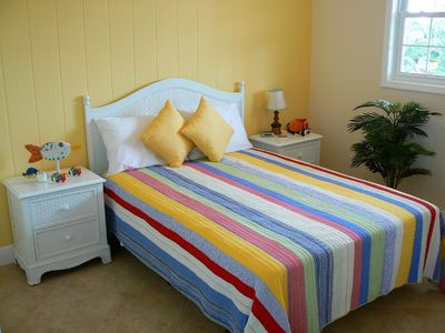 The 3rd bedroom has a queen-size bed and fun tropical colors.