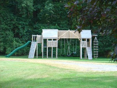 Huge Cedar Play Set for kids of all ages with rock wall, tire swing, and more!