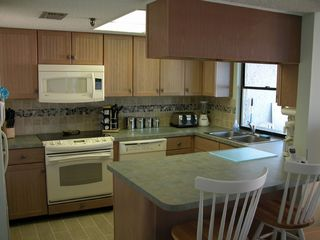 Redington Shores condo photo - kitchen w pass-thru window to balcony