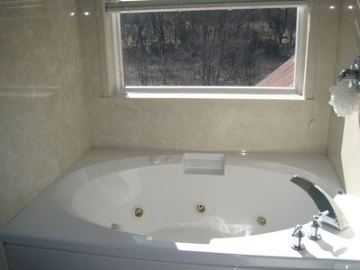 Whirlpool tub in master with river view