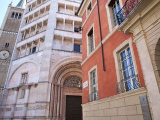 Parma hotel photo - The Palazzo Dalla Rosa Prati (red), the Battistero and the Tower of the Duomo
