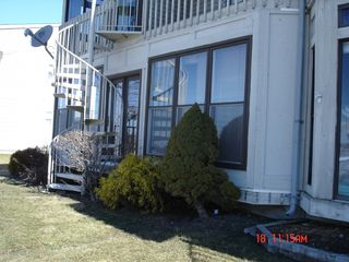 Oak Harbor condo photo - Back of condo, boat dock a few steps away!