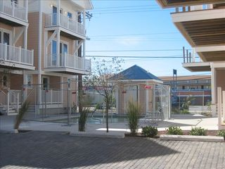 Vacation Homes in Ocean City townhome photo - Pool and Additional Parking Area