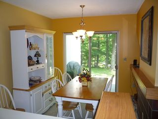 Killington townhome photo - Dining Room with sliding doors to enclosed deck & BBQ