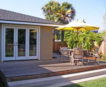 Back Patio with teak table and sun umbrella