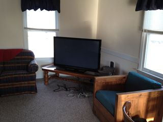 50 inch TV with cable and internet streaming. Use your Netflix account - North Topsail Beach cottage vacation rental photo