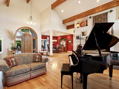 Tellico Lake estate rental - grand piano in gallery at front door