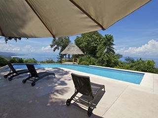 Dominical house photo - Relax outside under the sun umbrella shade