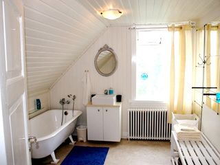 Reykjavik apartment photo - The bathroom is spacious and has an old cast iron bathtub with hand shower