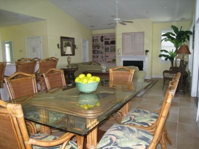 Dining area with living room in background