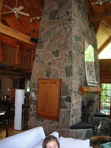 massive stone fireplace, with two large sitting areas with 4 couches etc