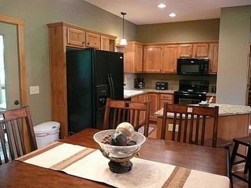 Kitchen island with granite top open to dining. BBQ grill just outside the door