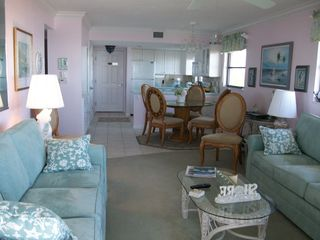 Sanibel Island condo photo - See the living room, dining room and kitchen from lanai - glass doors